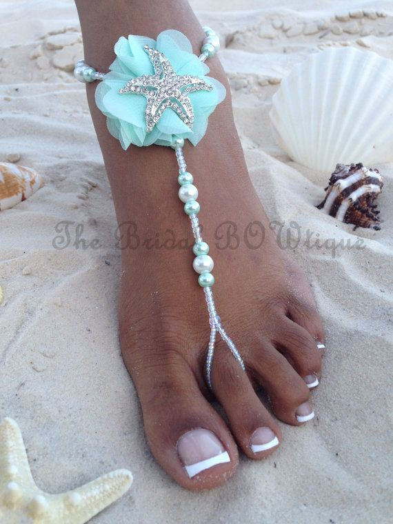 NEW DESIGN - Aqua mint starfish bridal pearl barefoot sandals.  The pair is very elegant and is made with pearl bead crystals. They are perfect for a beach wedding or a destination wedding. The pair shown here is made with white and aqua mint pearls crystals and embellished with a beautiful Aqua mint chiffon flower with a silver starfish. Want matching pairs in this design for your bridesmaids in your wedding colors? I can custom make these sandals in any wedding colors if available. Simply…