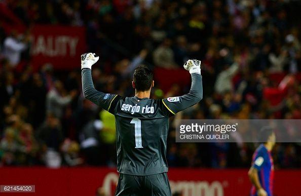 Sevilla's goalkeeper Sergio Rico Gonzalez reacts after Sevilla's midfielder Vitolo scored during the Spanish league football match Sevilla FC vs FC...