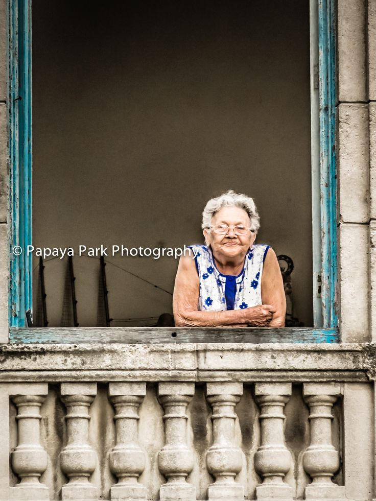 Local lady looking out of her window in Havana, Cuba.