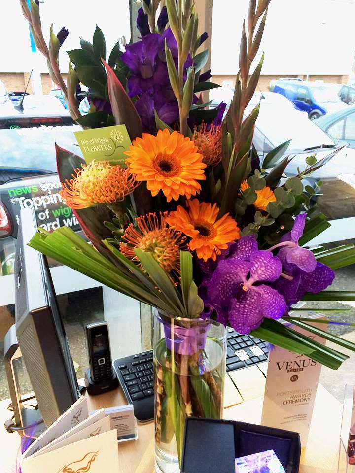 Flowers for an awards evening - colours reflecting the corporate brand colours of our client. http://www.isleofwightflowers.co.uk/