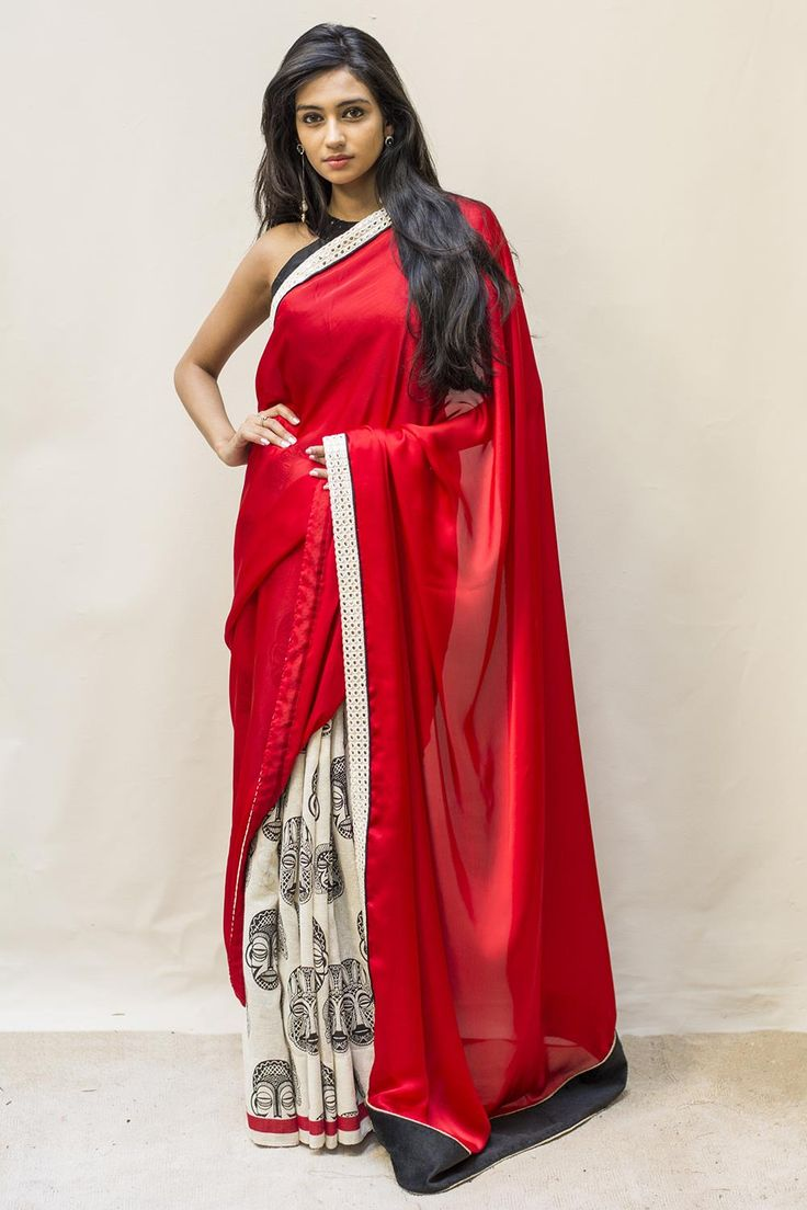 Wowsie again! What a nicely designed beauty this. In a soft satin chiffon red with a white faux mirror work border and a tribal motif black and white in jute net. A vision in red white and black, this is one saree you'll love to get your hands on.Keep the blouse slick and simple for this one. A sexy black sequinned blouse will steal the day or even a white mirror work blouse will work nicely with this striking piece. #houseofblouse #saree  #blouse #indianwear #india #fashion #bollywood #red