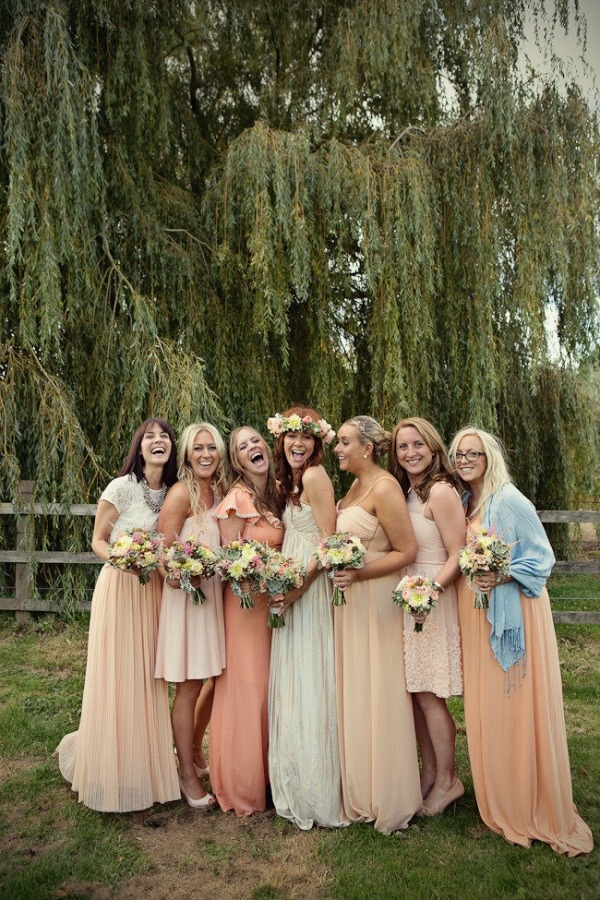 mismatched long bridesmaids dresses in shades of peach