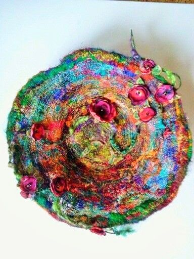 Made from small snippets of thread and fabric stitched between water soluble stabilizer