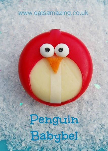 Creative Christmas food - easy penguin Babybel - perfect for Winter themed kids party or a fun snack - check out the blog post for more penguin themed foods!