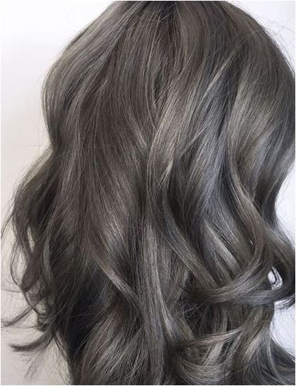 Apply silver bullet on top of Brunette hair with blonde highlights