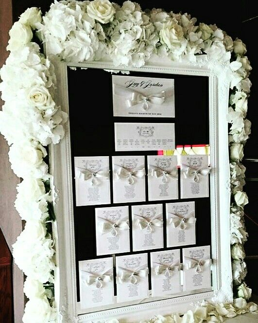 Floral wedding mirrored table plan with crystals. In collaboration with Lorraine Wood Weddings