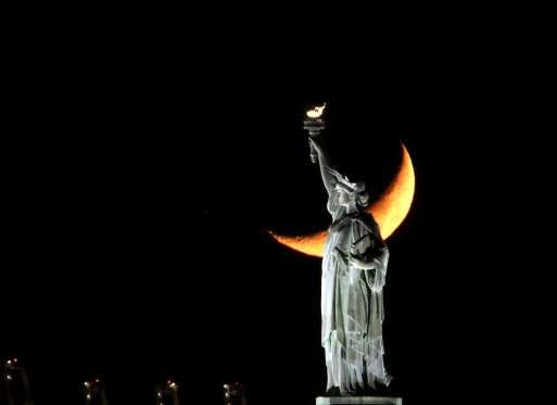 A Crescent Moon sets behind the Statue of Liberty - ZUMA Wire/REX/Shutterstock
