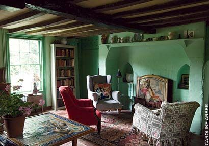 One of Virginia Woolf's homes, 'Monks House'. The Woolfs knocked down a central partition to create a large room where they sat, ate, and read endless books. Five windows keep it light throughout the day