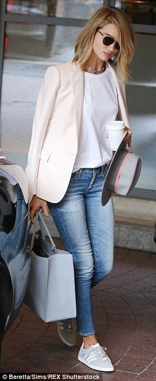 stylish office attire outfit idea including pastel blazer white top and jeans