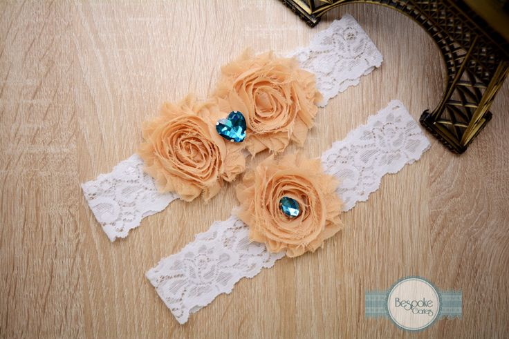 Wedding Garter Handmade of White Lace, Cream Nude Flowers and Aqua Rhinestones by BespokeGarters on Etsy