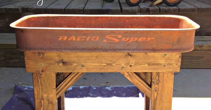An old, rusty wagon gets a new life as a table/planter! I took apart this vintage wagon, and built a wooden base for it. It is compact and perfect for small spa…