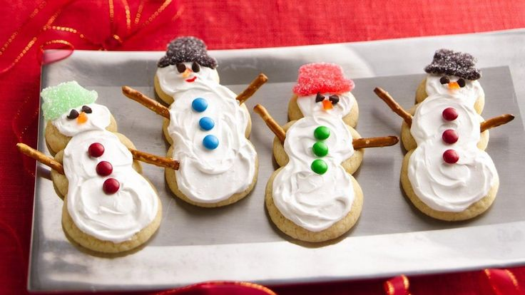 Sugar Cookie Snowmen recipe and reviews - Sugar cookies with no rolling needed! Making balls of cookie dough to create snowmen is kid fun and friendly.