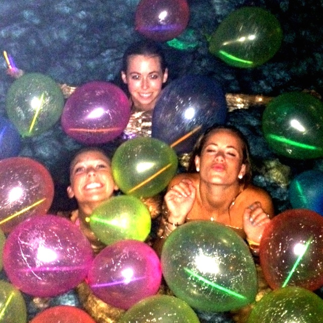 Night Party For Teens Glowsticks Inside Of Balloons In The Pool With People Swimming