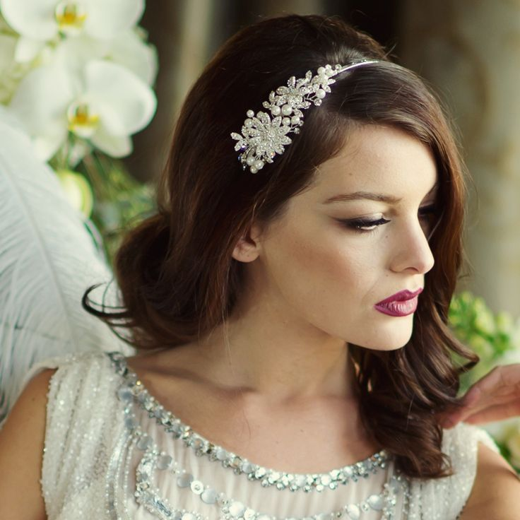 These beautifully designed, luxury headpieces, hair vines and headbands available in store now. Can be purchased or hired. Scarlett Bridal Headband. Stylish and Romantic design with an exquisite combination of clear crystals, faux ivory pearls and luxurious beadwork which combine to create a true treasure. Headband is silver plated.
