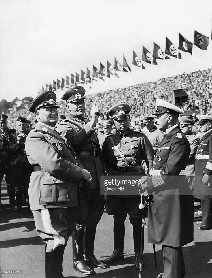 Hermann Goering, Reich Minister of Defense General Werner von Blomberg, the commander-in-chief of the Army High Command Baron Werner von Fritsch, and Admiral Erich Raeder talking to each other at the rally ground - 1935 - Photographer: Weltbild - Published by: 'B.Z.' Vintage property of ullstein bild