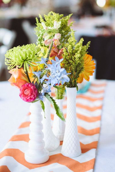 happy centerpieces |  Photography by paperantler.com |  Floral Design by bunkerhillflorist.net |   Read more - http://www.stylemepretty.com/2013/07/01/thompson-island-massachusetts-wedding-from-paper-antler-photography/