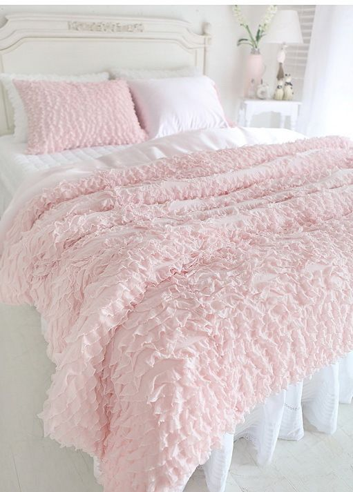 White And Pastel Pink Bed Spread.