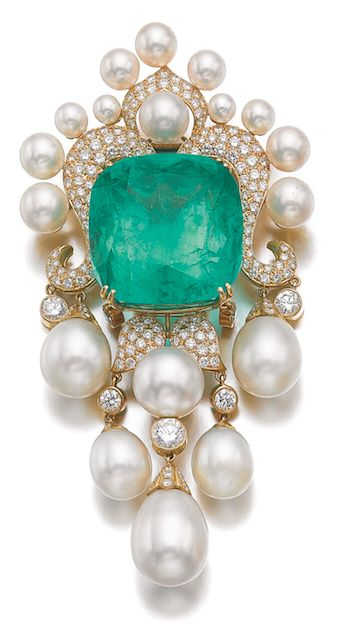 EMERALD, CULTURED PEARL AND DIAMOND PENDANT/BROOCH, AMR SHAKER Set with a cushion-shaped emerald weighing 104.97 carats, to a decorative mount highlighted with brilliant-cut diamonds .