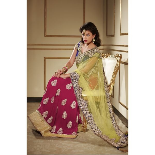 Red Net Embroidered Party Wear Lehenga Saree.This party wear lehenga saree is beautified with resham thread embroidered buttas studded with beads and stone with embroidered border and shimmer patch patti,add extra glam to the saree.