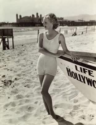 Actress Bette Davis Posing in Swimwear Next to Boat on the Beach 1930