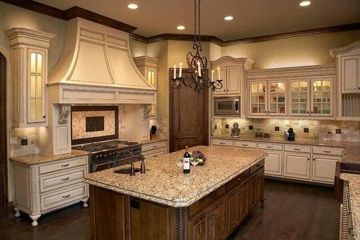 Full kitchen remodel with New Venetian Gold granite, stone backsplash, and oil-rubbed bronze deco inserts.