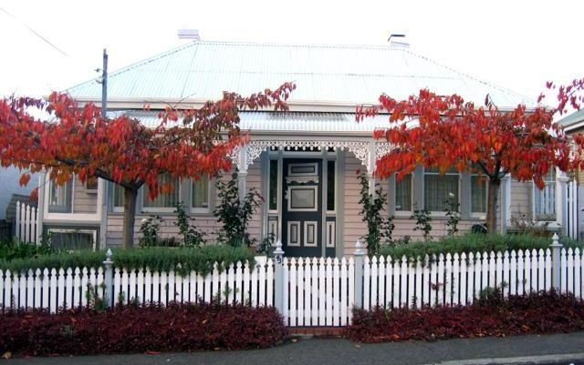This beautiful home in Tasmania, Australia is over a hundred years old. White picket fence and delicate lattice work make this cottage style home delightful.