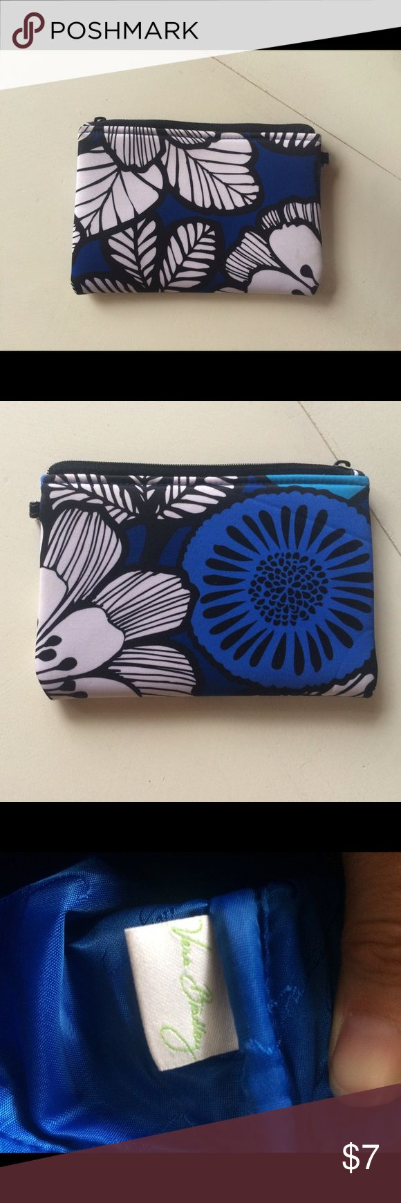 "Vera Bradley pouch clutch zip small blue floral This is a Vera Bradley wristlet, unfortunately the strap is missing and with it also the zipper pull. It does still zip so could be repaired. Otherwise in good shape with a little bit of a brown spot on the white flower near the corner. Would most likely wash or spot clean out. 7.5""x5.5"" Vera Bradley Bags Clutches & Wristlets"