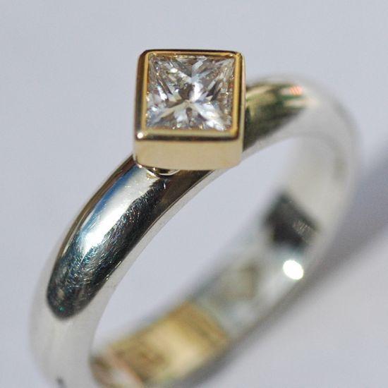 Set on the cross diamond and platinum engagement ring