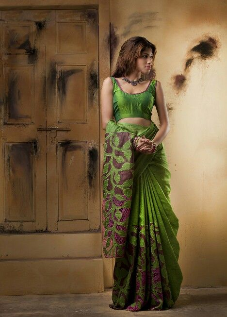 Leaf green tussar silk saree with a mix of applique and cutwork