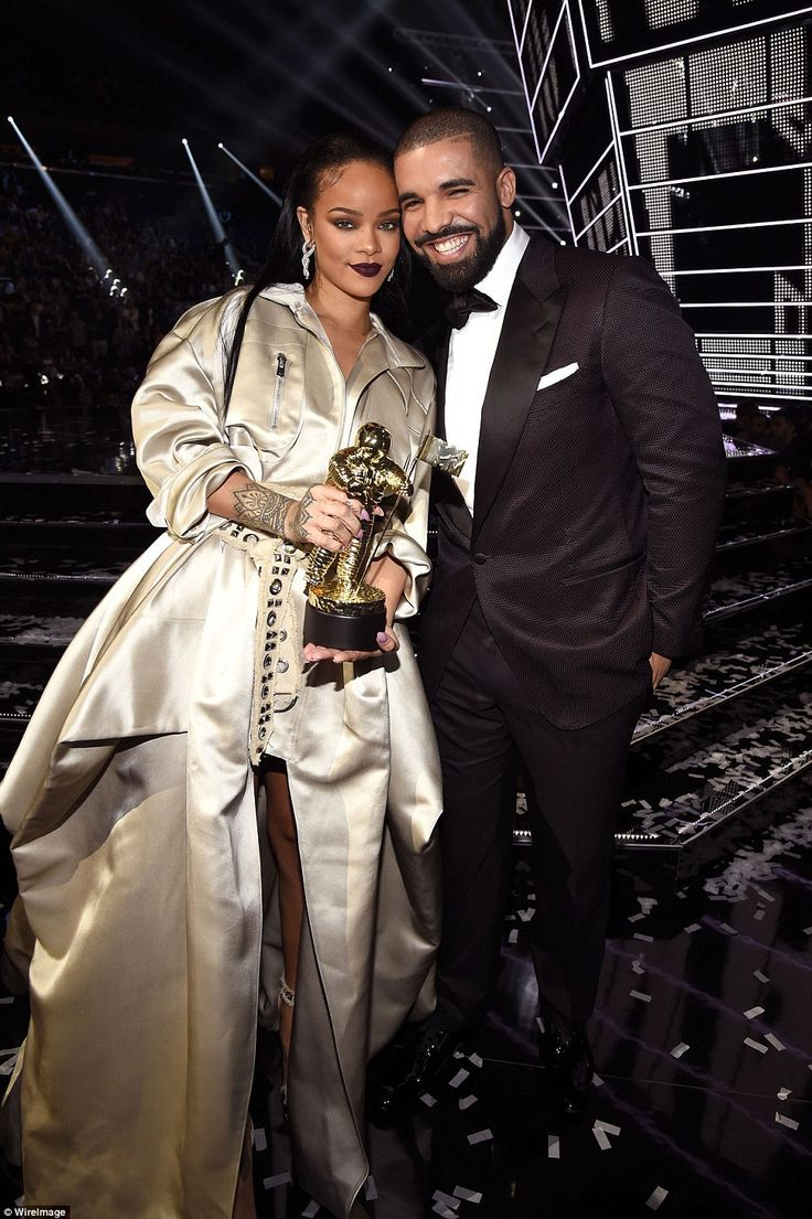 Picture perfect: The Hotline Bling singer cosied in close to as Rihanna proudly showed off her award