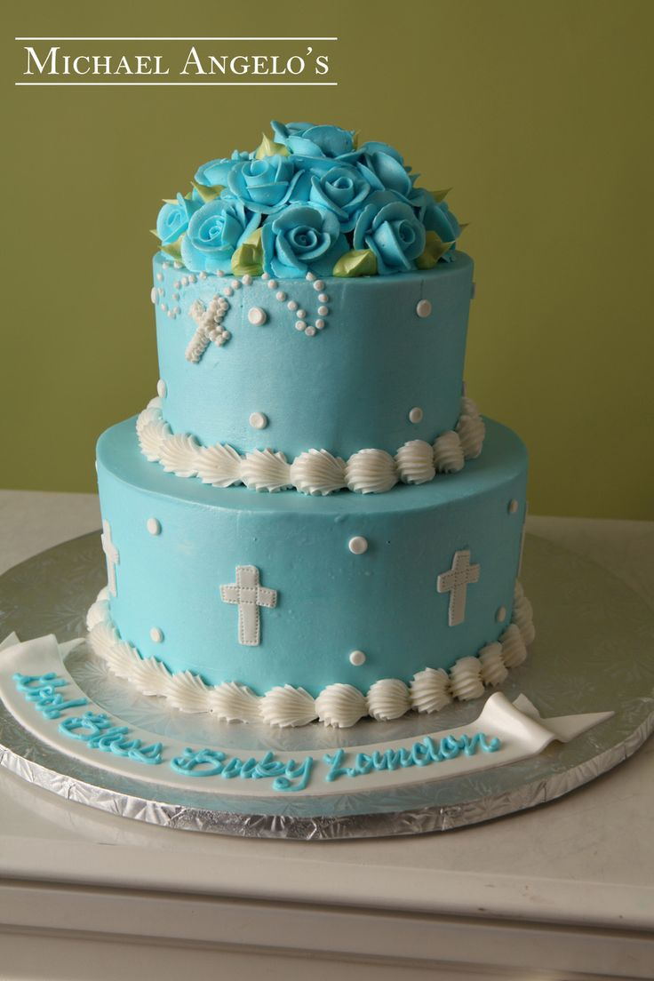 Holy Rosary with Blue Flowers #31Religious This cake is decorated in blue buttercream. The top layer is covered with a large, beautiful cluster of roses. The cross cut-outs and the rosary piped on really make this cake a perfect design for any religious occasion.