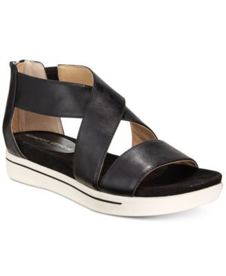 Adrienne Vittadini Claud Sport Flatform Sandals $79.00 Crisscross ankle straps and a flatform design make Adrienne Vittadini's Claud sandals from the Sport Collection the perfect option for your active lifestyle.