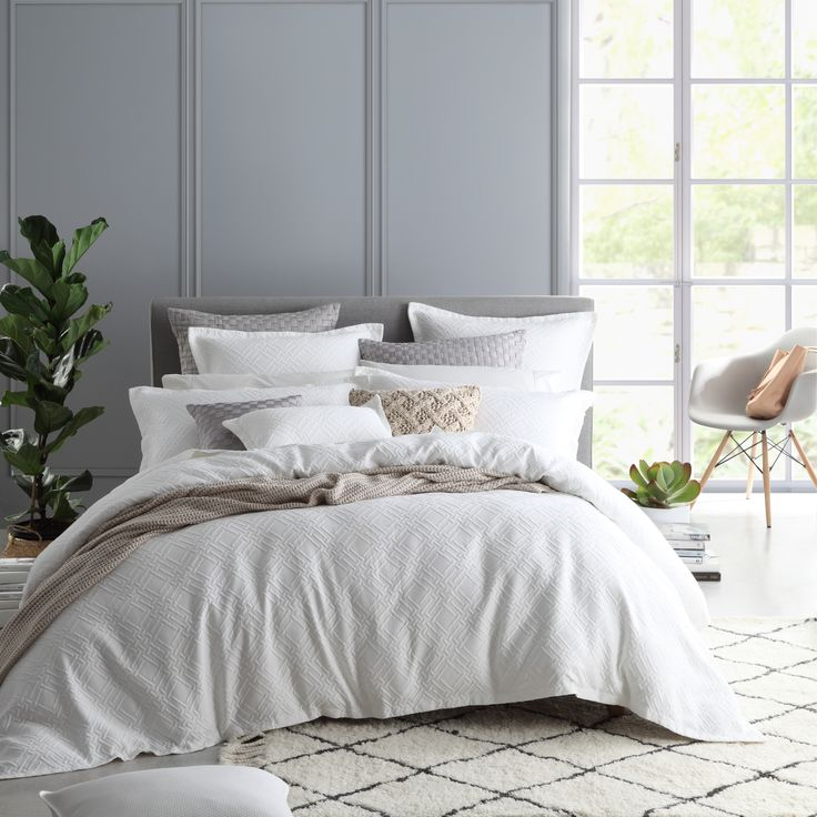 Fitzroy White brings classic simplicity to the bedroom. Soft cotton matelasse is woven with a diamond geometric pattern, giving subtle depth and tactility to the fabric. The edges are tailored with a self-flange to complement this sophisticated look. #privatecollection #legendlinen