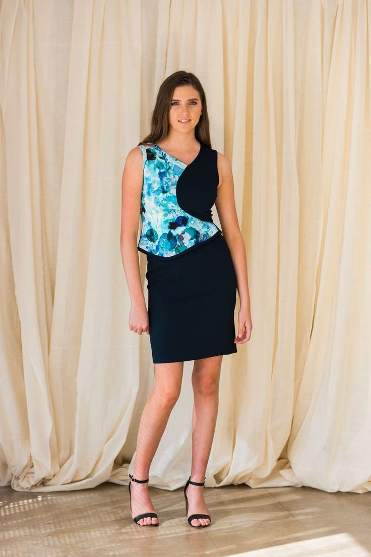 """An+exquisite+sleeveless+knee+length+fully+lined+piece+crafted+by+D.Exterior+from+luxurious+viscose+featuring+contrast+frill+in+printed+watercolours+fabric.+Perfect+for+formals+cocktails+and+weddings.<span+style=""""color:+#999999;""""><em>RRP:+$700</em></span>"""