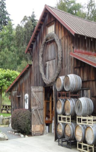 Barn With Old Barrels On Side