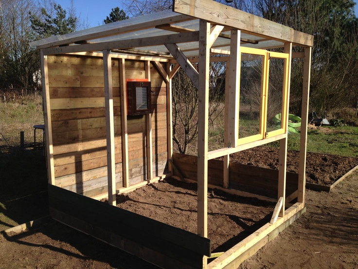 Diy greenhouse, work in progress. North side is timbered closed with wood because of the cold.