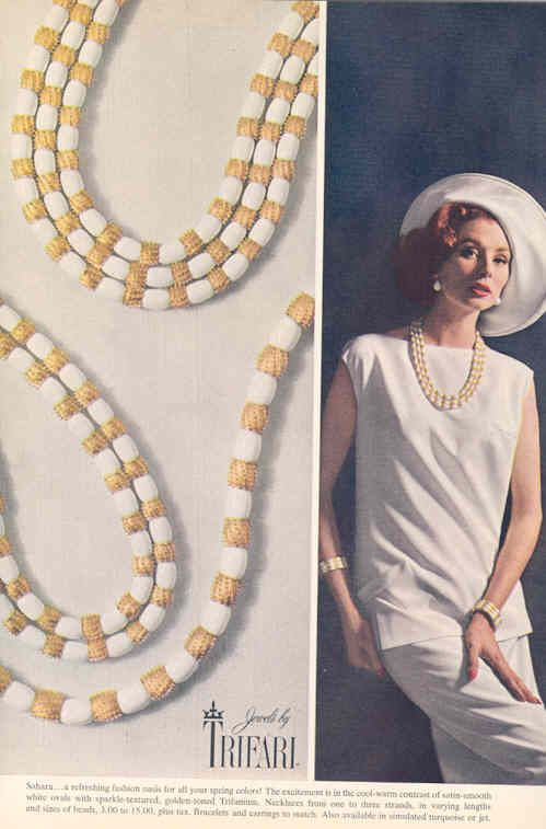 "1963 - TRIFARI - ADS - ""Sahara Collection"" - Sahara... a refreshing fashion model for alla your ---- with sparkle-scaturned, golden- -.-.-.-. Trifanium. Necklace _._._._.-- --,-.-.,- modeled by Suzy Parker Harper's Bazaar 1963"