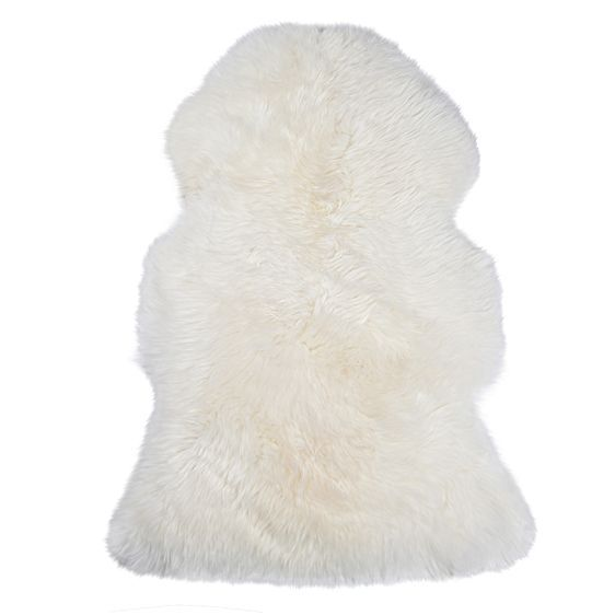 Enhance the luxurious softness of your lounge or bedroom with the plush pure wool feel of the Sheepskin Animal Hide Rug from NSW Leather Co, the perfect addition for the colder months.