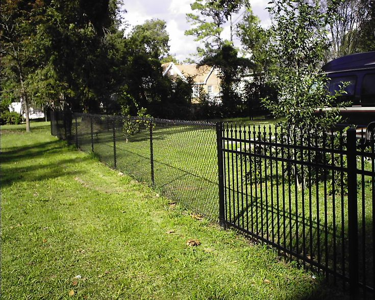 Black chain link fence with wrought iron gate