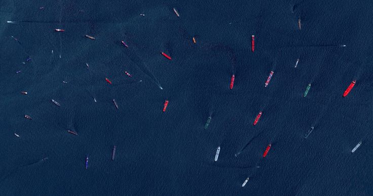 The Port of Singapore ships a fifth of the world's cargo containers, making it the world's second busiest port. Reprinted with permission from Overview by Benjamin Grant, copyright (c) 2016. Published by Amphoto Books, a division of Penguin Random House, Inc.   Images (c) 2016 by DigitalGlobe, Inc.