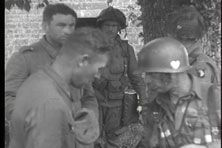 101st Airborne Division paratroopers at the Marmion Farm complex near Ravenoville, Normandy, June 6th or 7th, 1944. Trooper at right searching German prisoner is from the 502nd Parachute Infantry Regiment.