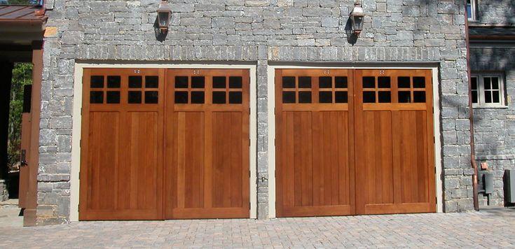 Carriage House Garage Doors Against Stone Veneer Nice