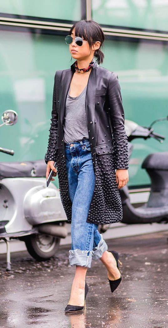 Margaret Zhang wearing cuffed baggy jeans, an embellished black leather trench…