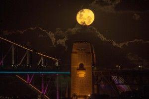 Full moon over the Sydney Harbour Bridge at Vivid Festival