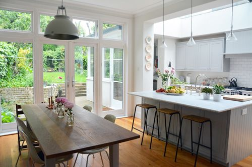 I love this kitchen with the wall of windows, light coloured space. Beautiful! Living With Kids: Courtney Adamo