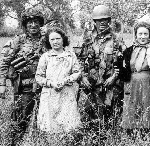 Forrest Guth and Floyd Talbert with locals on D-day morning.