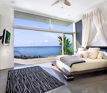 white wall color scheme and modern bedding sets in beach bedroom design ideas