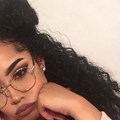 One band clear aviator glasses, rose red matte lipstick, eyebrows on fleek and wavy hair? Seems like you're trying to stunt on someone. The question is..who? -A The Baddie