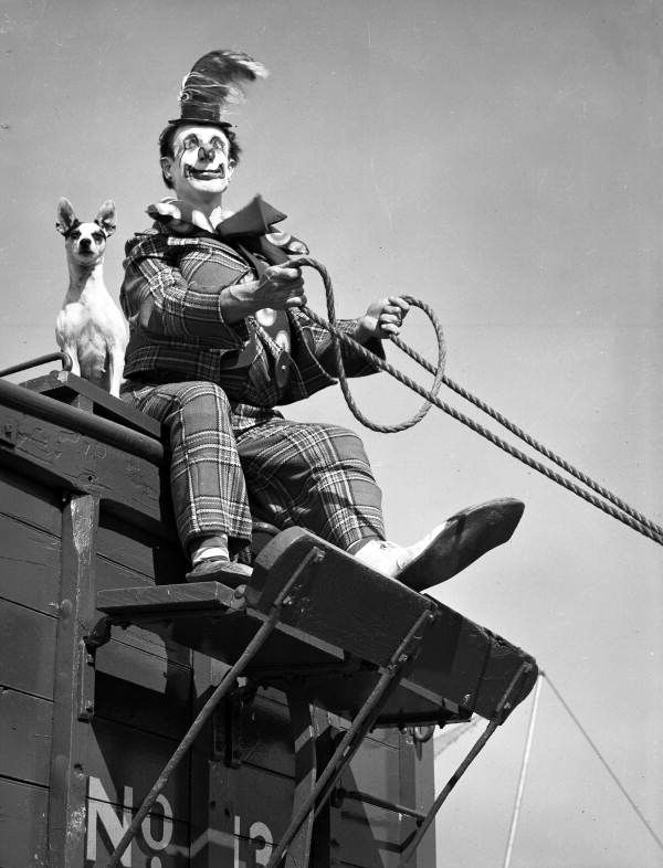 Ringling Circus clown Buzzy Potts with his dog Daisy June. Photographed on March 8, 1949 by Joseph Janney Steinmetz (1905-1985).