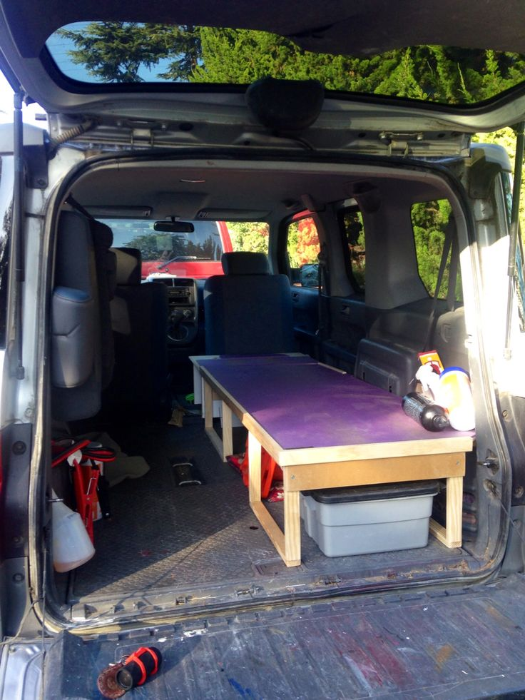 Honda Element micro-camper, single bed platform (storage underneath). Left  rear seat folded up (can be lowered with bed in place). Bed is x x